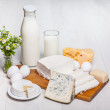 Milk and food on wooden background — Stock Photo #30831297