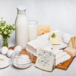 Milk and food on wooden background — Stock Photo