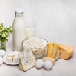 Milk and food on wooden background — Stock Photo #30831343
