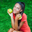 Young beautiful brunette woman holding two apples — Stock Photo #31086319