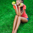 Young beautiful brunette woman holding two apples — Stock Photo #31086769