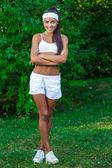 Young beautiful brunette sportswoman outdoor — Stock Photo