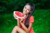 Young beautiful brunette woman holding watermelon — Stock Photo