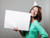 Young brunette woman holding blank sign — Стоковое фото