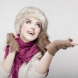 Young beautiful woman wearing fur hat and scarf — Stock Photo