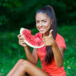Young beautiful brunette woman eating watermelon — Stock Photo