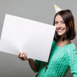 Young brunette woman holding blank sign — Stock fotografie