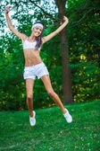 Young beautiful brunette sportswoman outdoor — Stock Photo