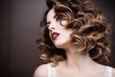 Beauty styled closeup portrait of a young woman — Stock Photo
