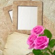 Grunge frame with roses and paper — Stock Photo #12391989