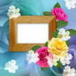 Wooden photo frame with roses — Stock Photo #16340905