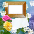 Wooden photo frame with roses — Stock Photo #16341045