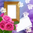 Wooden photo frame with roses — Stock Photo