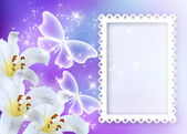 Lilies blossom with butterflies and photo frame — Stock Photo