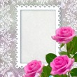 Roses and openwork frame — Stock Photo