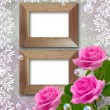 Roses and wooden frame — Stock Photo #21184715