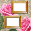 Pink roses and wooden photo frame — Stock Photo #21184767