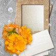 Grunge frame with roses and paper — Stock Photo