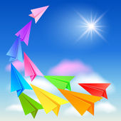 Paper airplanes flying in the sky — Stockvector