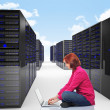Woman in datacenter — Stock Photo #10678725