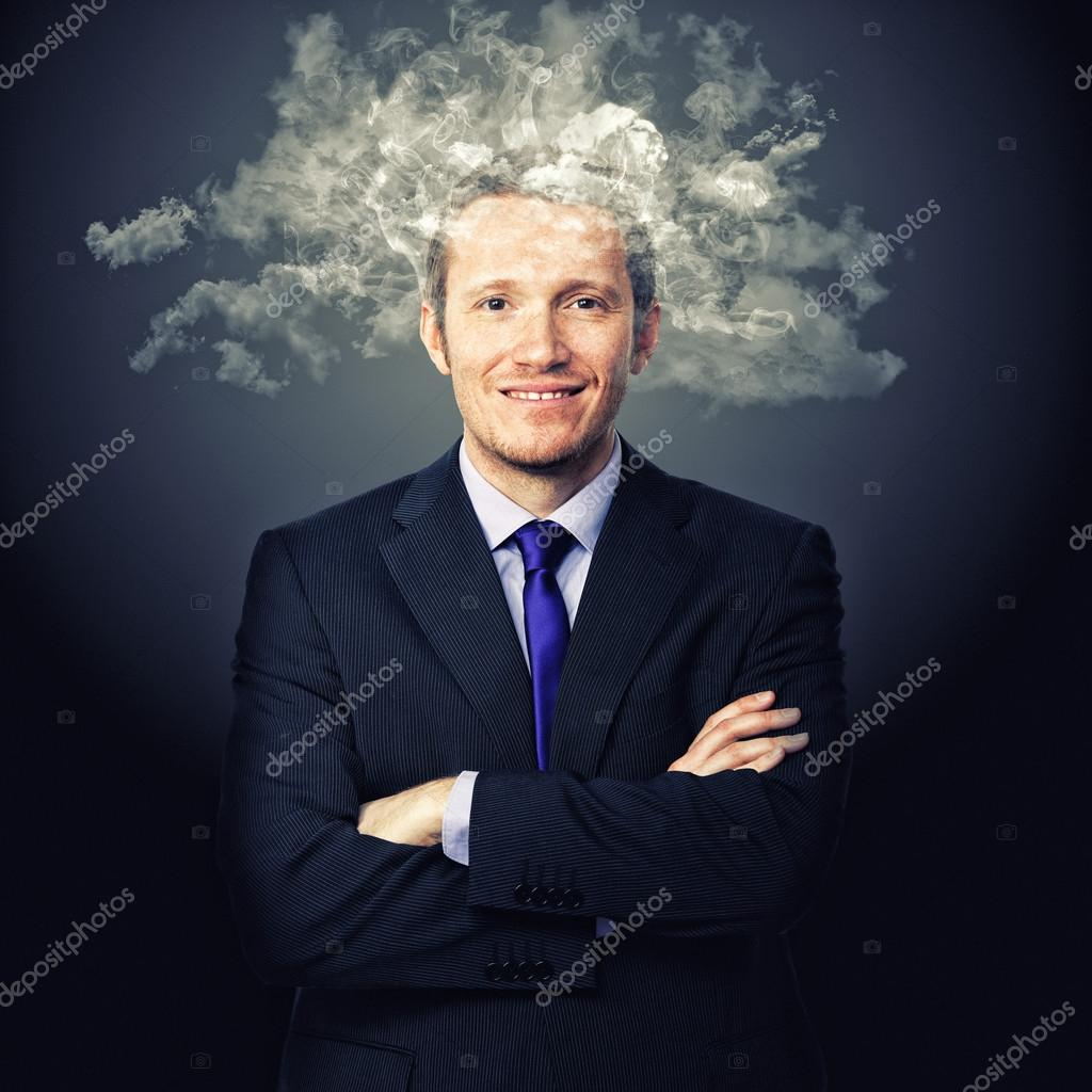 Portrait of businessman with smoke on his head — Stock Photo #14119775