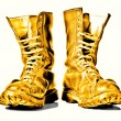 Golden combat boots — Stock Photo