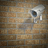 Cctv on brick wall — Stock Photo