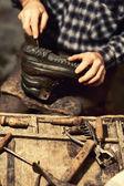 Cobbler at work — Stock Photo