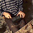 Cobbler at work - Stock Photo