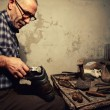 Cobbler at work — Stock Photo