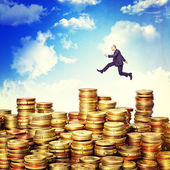 Jump on money — Stock Photo