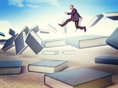 Man on books — Foto de Stock
