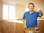 Friendly handyman in new house — Stock Photo