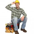 Happy worker on toolbox — Stock Photo #2449103