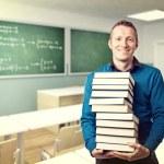 Teacher and books — Stock Photo #24968337