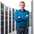 Man in datacenter - Stock Photo