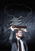 Businessman and bad weather cloud — Stock Photo