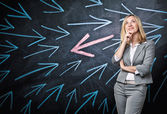 Thinking woman and arrows — Stock Photo