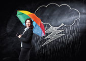 Woman with umbrella and rain — Stock Photo