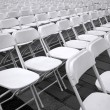 Rows of White Plastic Chairs — Stock Photo #12691822