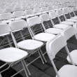 Stock Photo: Rows of White Plastic Chairs