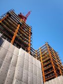 Modern Highrise Construction with Red Crane — Stock Photo