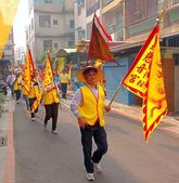 Carrying Yellow Religious Flags — Photo