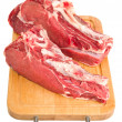 Stock Photo: Raw meat on wood board