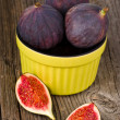 Fresh figs in bowl - Stock Photo