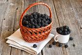 Blackberries on wooden rustic table — Stock Photo
