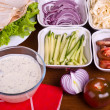Foto Stock: Sauce and Variety of vegetables for cooking shawarma