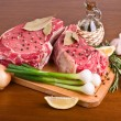 Stock Photo: Raw meat on wooden table