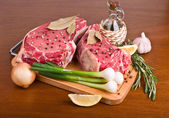 Raw meat on wooden table — Stock Photo
