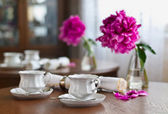 A cup of tea and napkin and peony — Stock Photo